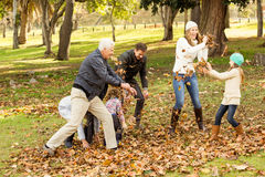 Happy family playing in the park together. On an autumns day Stock Photo
