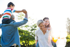 Happy family playing at the park Royalty Free Stock Image