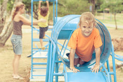 Happy family playing on the playground Stock Images