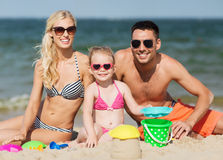 Happy family playing with sand toys on beach Royalty Free Stock Images