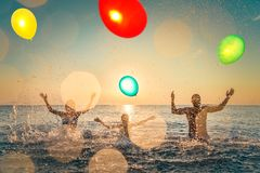 Happy family playing in the sea stock image