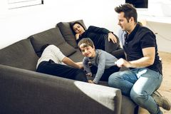A happy family playing and smiling on the couch at home. Concept of love between parents and children royalty free stock photo