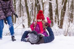 Happy family playing with snow in winter forest royalty free stock image