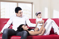 Happy family playing on sofa Stock Photos