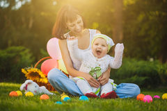 Happy family are playing in the summer park Royalty Free Stock Images