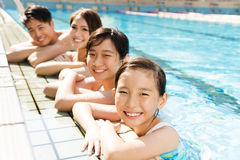 Happy family playing in swimming pool Stock Images