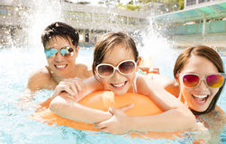 Happy family playing in swimming pool. Happy asian family playing in swimming pool Stock Image