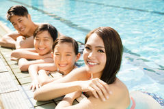 Happy family playing in swimming pool. Happy asian family playing in swimming pool Royalty Free Stock Photos