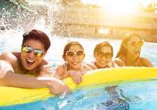 Happy family playing in swimming pool Royalty Free Stock Image
