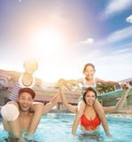 Happy family playing in swimming pool. Happy asian family playing in swimming pool Stock Photo