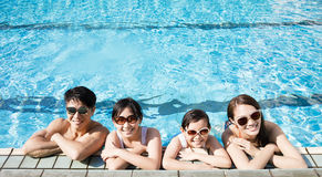Happy family playing in swimming pool. Happy asian amily playing in swimming pool Stock Image