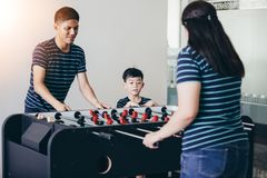 Happy Family playing table football for relax on holiday in home royalty free stock photos