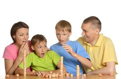 Happy family playing at table Stock Images