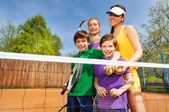 Happy family after playing tennis in summertime Stock Images