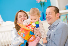 Happy family playing together royalty free stock photos