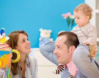 Happy family playing together Stock Image