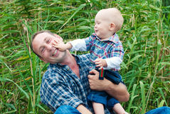 Happy Family Playing together. Dad and Son in the Park stock image