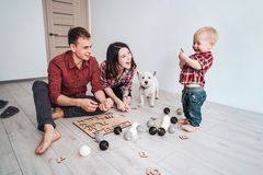 Happy family are playing together on the floor. A mother, father and son are playing together on the floor Stock Images