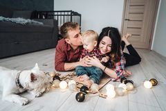 Happy family are playing together on the floor. A mother, father and son are playing together on the floor Royalty Free Stock Photo