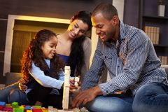 Happy family playing together at home Stock Photography