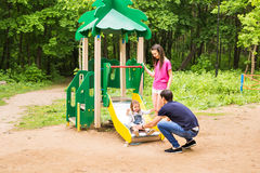 Happy family playing together at outdoor park Stock Images