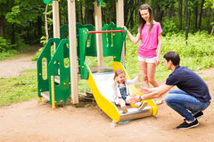 Happy family playing together at outdoor park Stock Photography