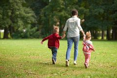 Happy family playing together outdoor in park Royalty Free Stock Images