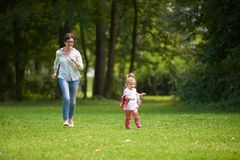 Happy family playing together outdoor in park Royalty Free Stock Photo