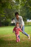 Happy family playing together outdoor in park Stock Photography