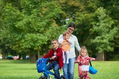 Happy family playing together outdoor in park Royalty Free Stock Image
