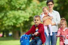 Happy family playing together outdoor in park Stock Image