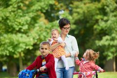 Happy family playing together outdoor in park Royalty Free Stock Photography