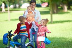 Happy family playing together outdoor in park Stock Photo