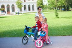 Happy family playing together outdoor in park Royalty Free Stock Photos