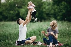 Happy family playing together, parents with their little child r stock photos