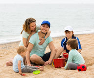 Happy family playing together at sandy beach. At summer day Stock Photos