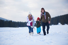 Happy family playing together in snow at winter Stock Photography