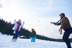 Happy family playing together in snow at winter Royalty Free Stock Photo