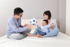 Happy family playing toy soccer