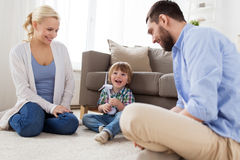 Happy family playing with toy wind turbine Royalty Free Stock Photos