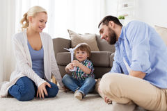 Happy family playing with toy wind turbine Stock Image