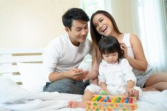 Happy family playing toy at home royalty free stock photography