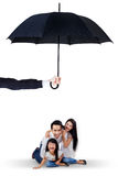 Happy family playing under umbrella in studio. Image of cheerful family playing together in the studio under umbrella. Life and family insurance concept Royalty Free Stock Photos
