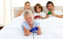 Happy family playing video game Stock Image