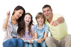 Happy family playing video game Stock Photography