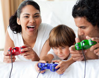 Happy family playing video games Stock Photo