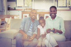 Happy family playing video games Stock Photos