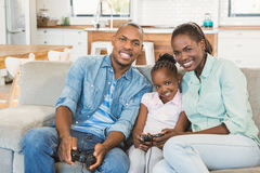 Happy family playing video games Royalty Free Stock Image