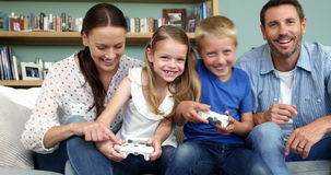 A happy family is playing video games. In the lounge stock footage