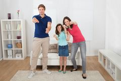 Happy family playing videogame Stock Photos